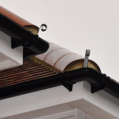 Dormer roofing with hip irons on hipped ends