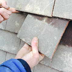 repairing and replacing a roof tile