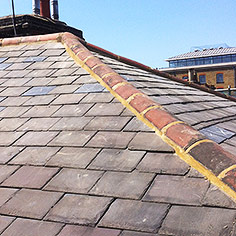 Tiled roof replacement slate tile repairs - see new slate tiles marked with X